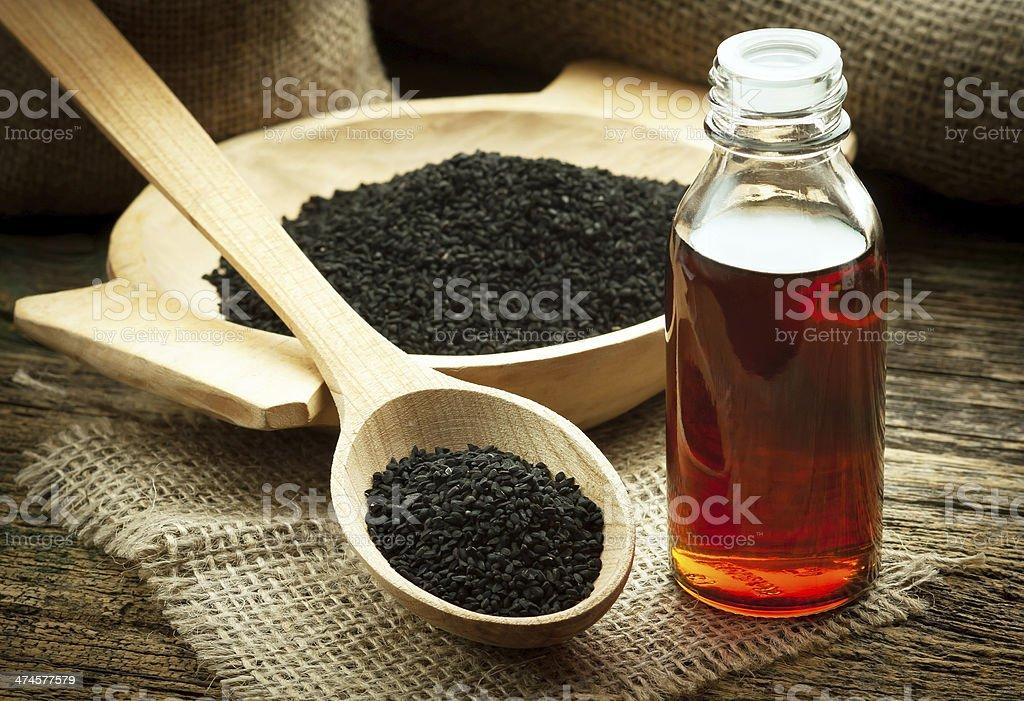 Nigella sativa oil stock photo