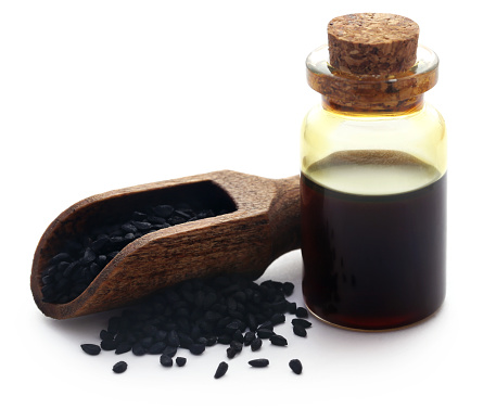 istock Nigella seeds and essential oil 1014130764
