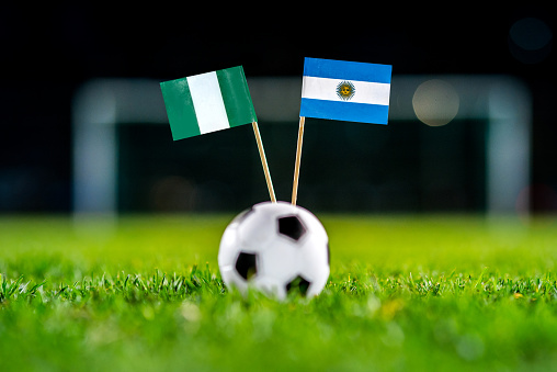 Nigeria - Argentina, Group D, Tuesday, 26. June, Football, World Cup, Russia 2018, National Flags on green grass, white football ball on ground.