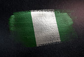 Nigeria Flag Made of Metallic Brush Paint on Grunge Dark Wall