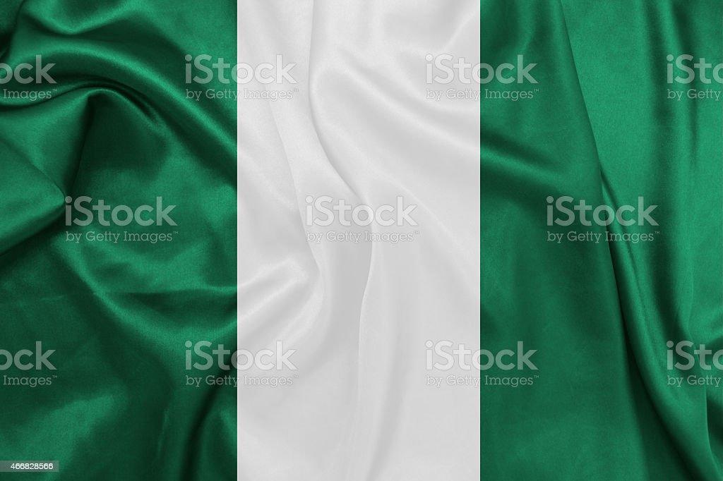 Nigeria, agitando bandera nacional de seda textura - foto de stock
