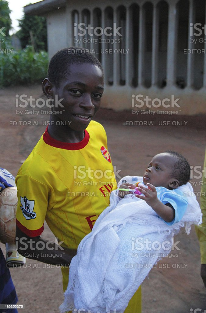 Nigerian boy and newborn stock photo