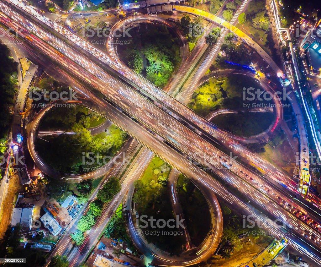A Night Aerial Drone View of Semanggi Bridge Jakarta Indonesia stock photo
