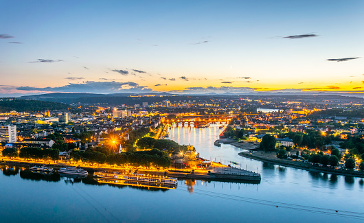 Night aerial view of confluence of Rhein and Mosel rivers in Koblenz, Germany