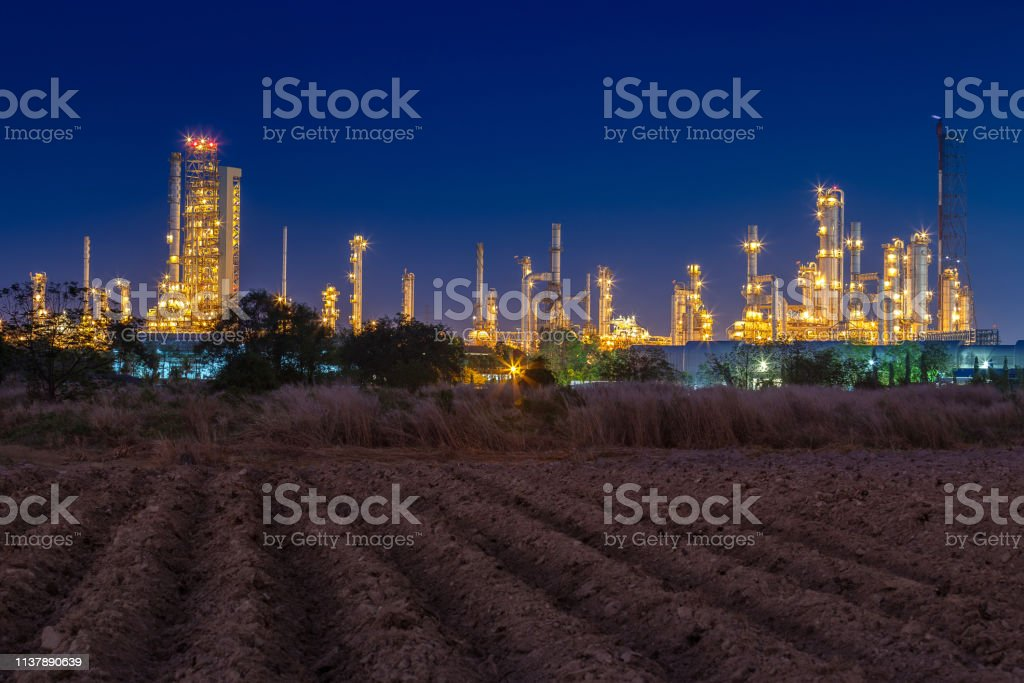 night view after sunset time with agiculture field and chemical plant...
