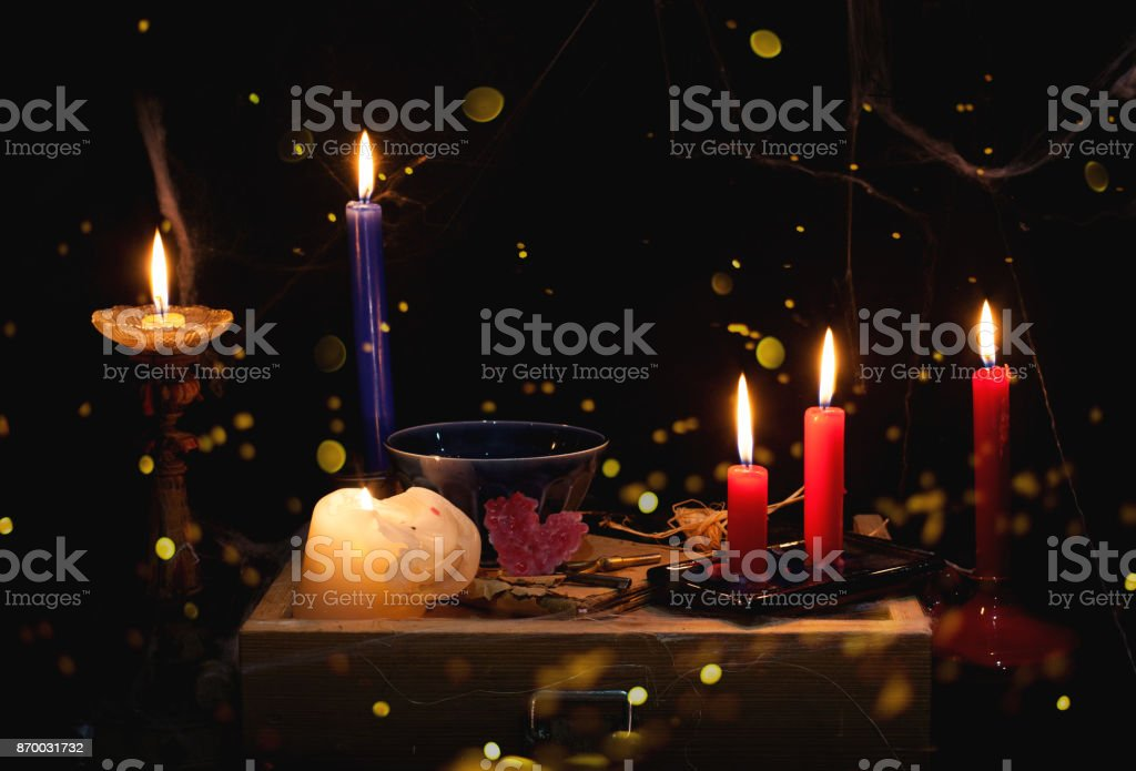 night and candle - divination of wax - polish tradition  - divination from  wax - evening predictions on the eve of St. Andrew stock photo