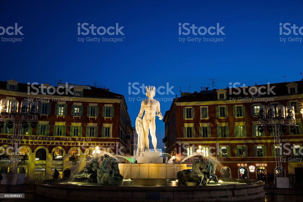 Night Apollo Statue, Fontaine du Soleil, Place Massena, Nice, France stock photo