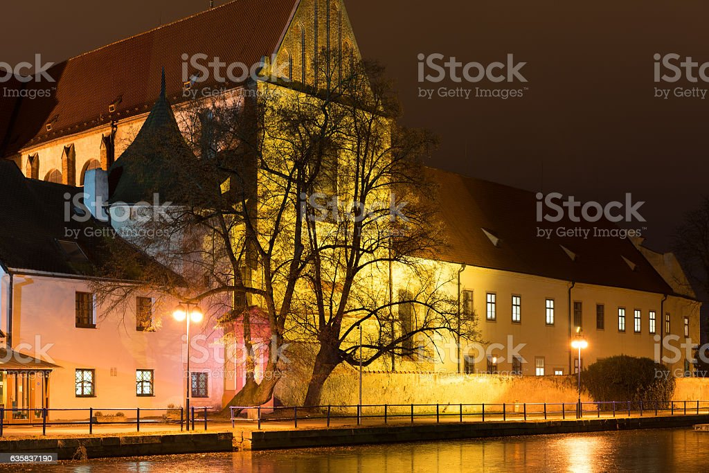 Night architecture in city. Church on the bank of river. stock photo