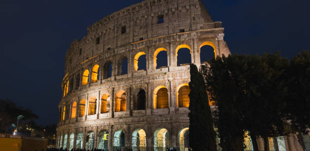 Night at Colosseum The Colosseum or Coliseum is an oval amphitheatre in the centre of the city of Rome, Italy. ARPA stock pictures, royalty-free photos & images