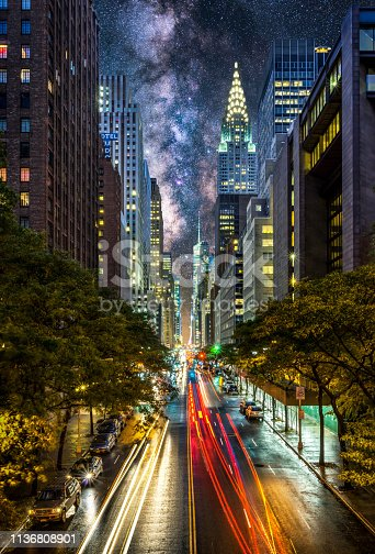light trails in E42nd street of Manhattan at night with milkyway in the sky. New York