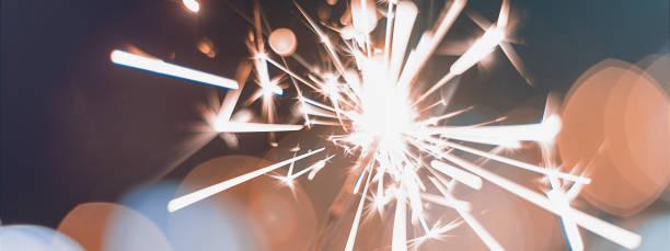 night background with a sparkler. sparkler  bokeh - fourth of july стоковые фото и изображения