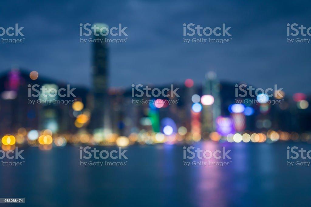 Night blurred bokeh Hong Kong office building at twilight foto de stock royalty-free