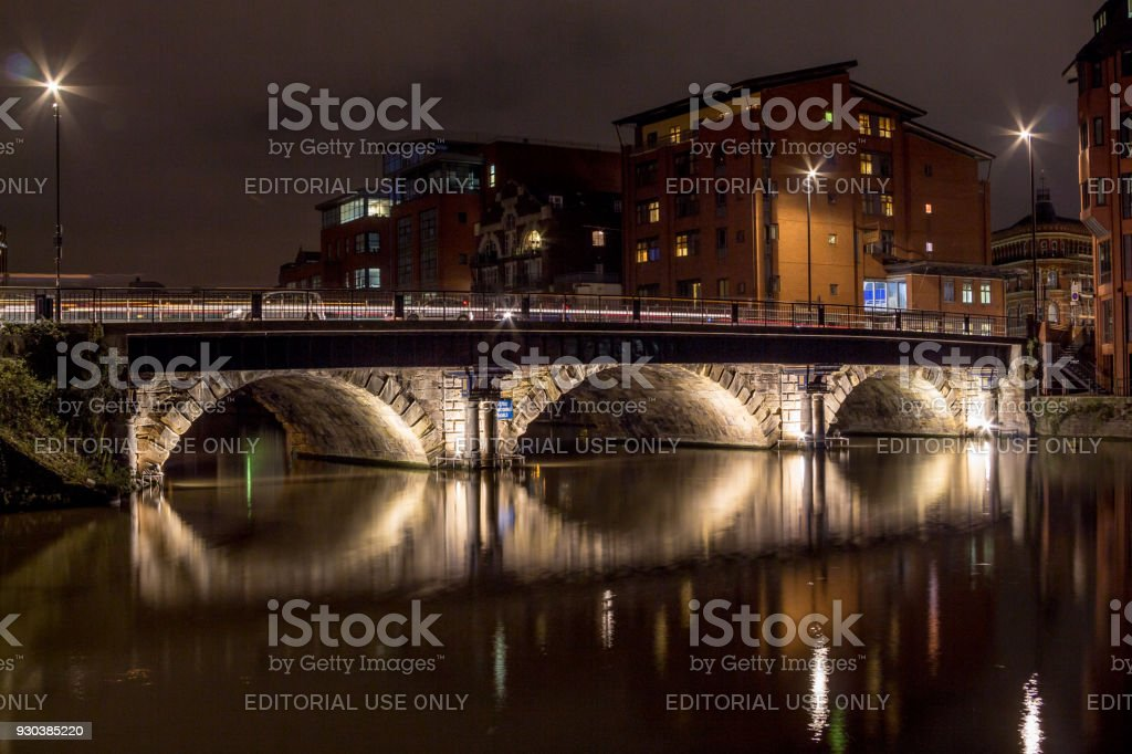 Night bridge over a river with long reflections stock photo
