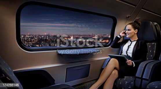 business woman traveling by train at the night time