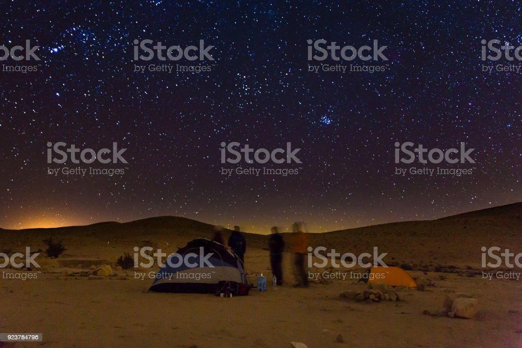 Night camping tents people talk, night stars sky. stock photo