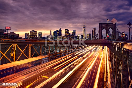 istock Night car traffic on Brooklyn Bridge in New York City 492884680