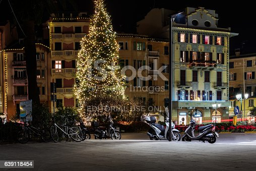 istock Night central street with Christmas tree and parked motorbikes 639118454