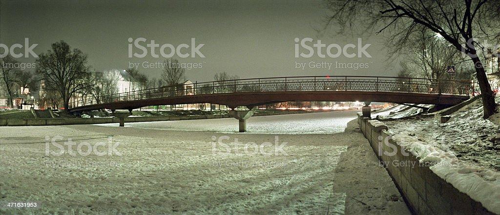 Night city. A pedestrian bridge. royalty-free stock photo