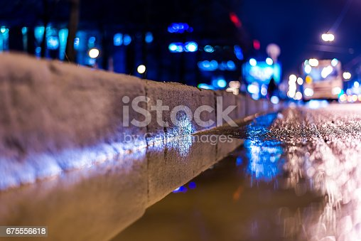 820883024 istock photo Night city after rain, a reflection of the city at night in the water 675556618