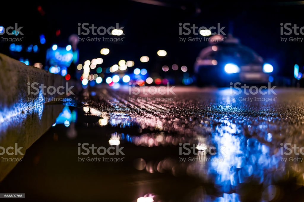 Night city after rain, a reflection of the city at night in the water royaltyfri bildbanksbilder