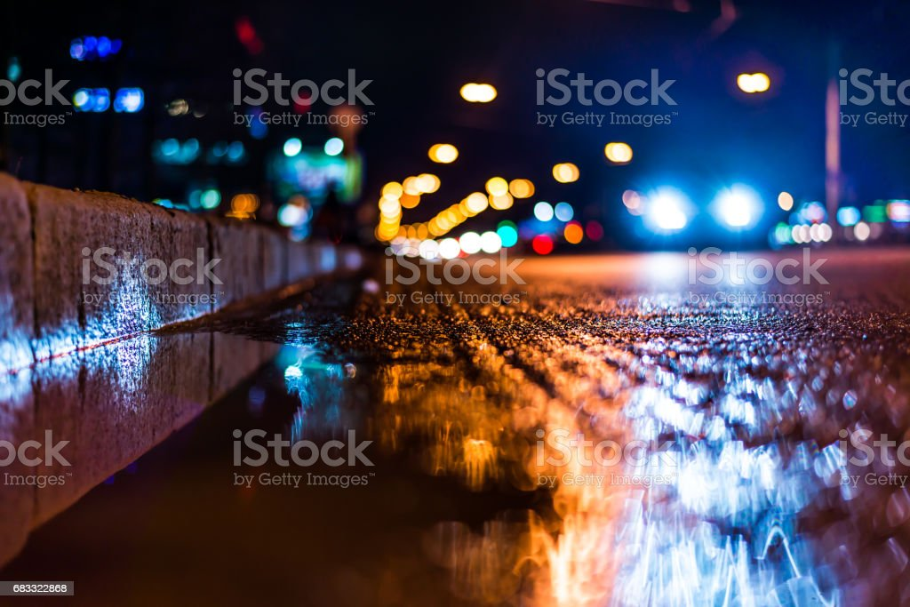 Night city after rain, a reflection of the city at night in the water royalty free stockfoto