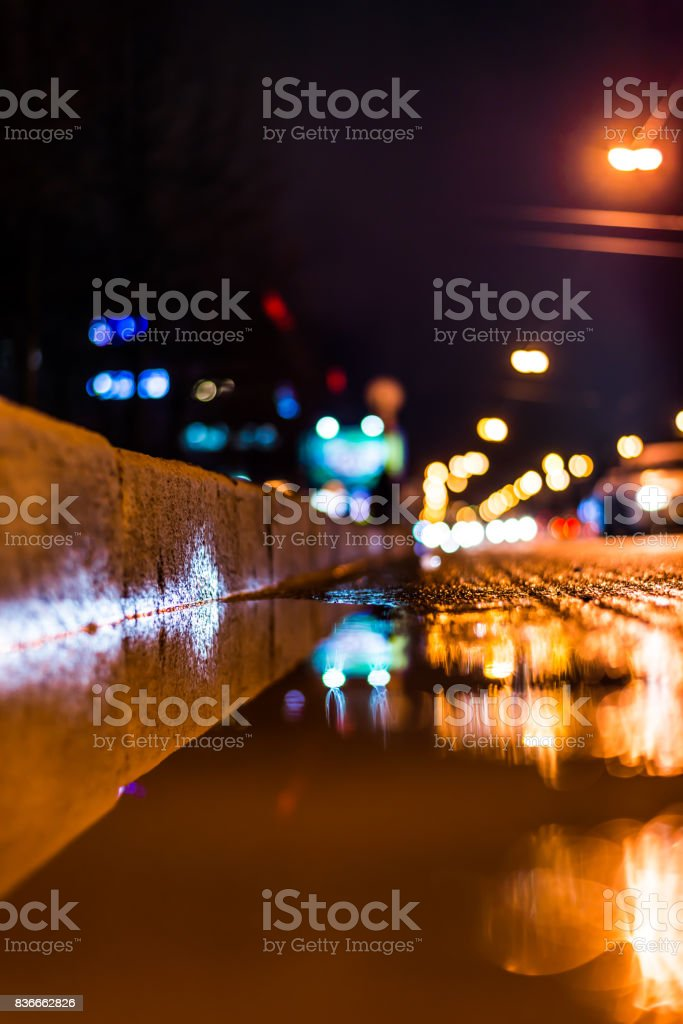 Night city after rain, a reflection of the city at night in the water stock photo