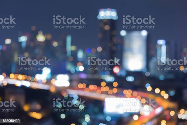Night city blurred bokeh lights aerial view, city downtown