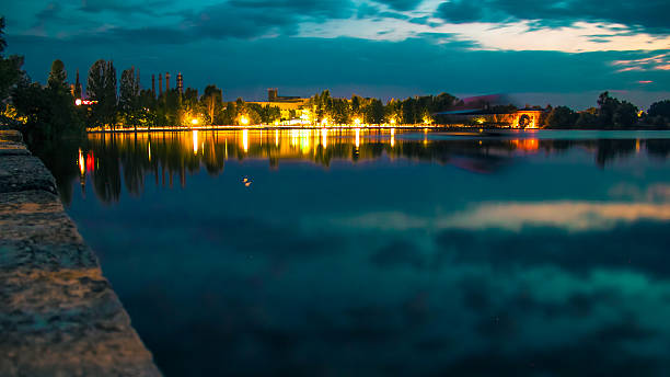 Night city by the lake. stock photo