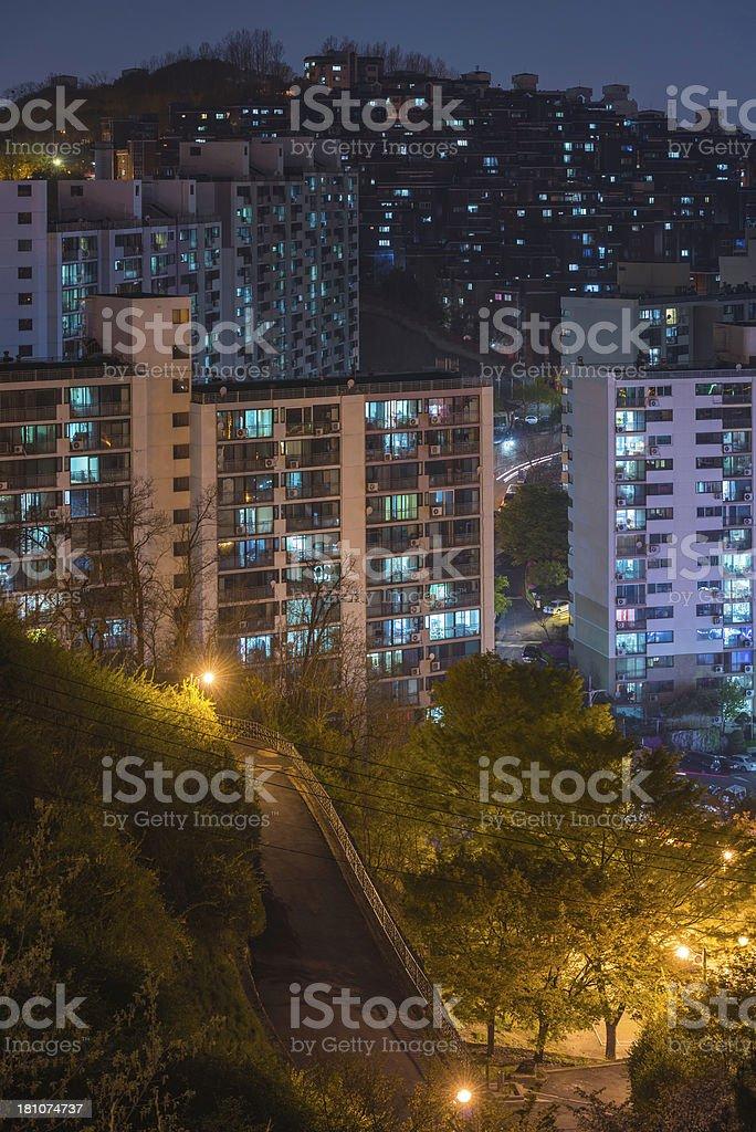 Night city lights apartment windows illuminated highrise housing royalty-free stock photo