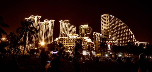night city Sanya all lights, bright lights adorn the building. the tropics. stock photo