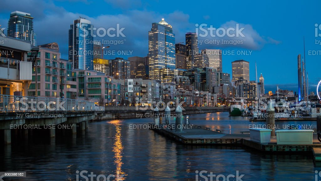 Night city towers reflections on the water stock photo