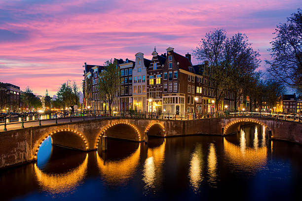 Night city view in Amsterdam, Netherlands. Night city view in Amsterdam, Netherlands. Canal and typical dutch houses at night in Amsterdam, Netherlands canal stock pictures, royalty-free photos & images