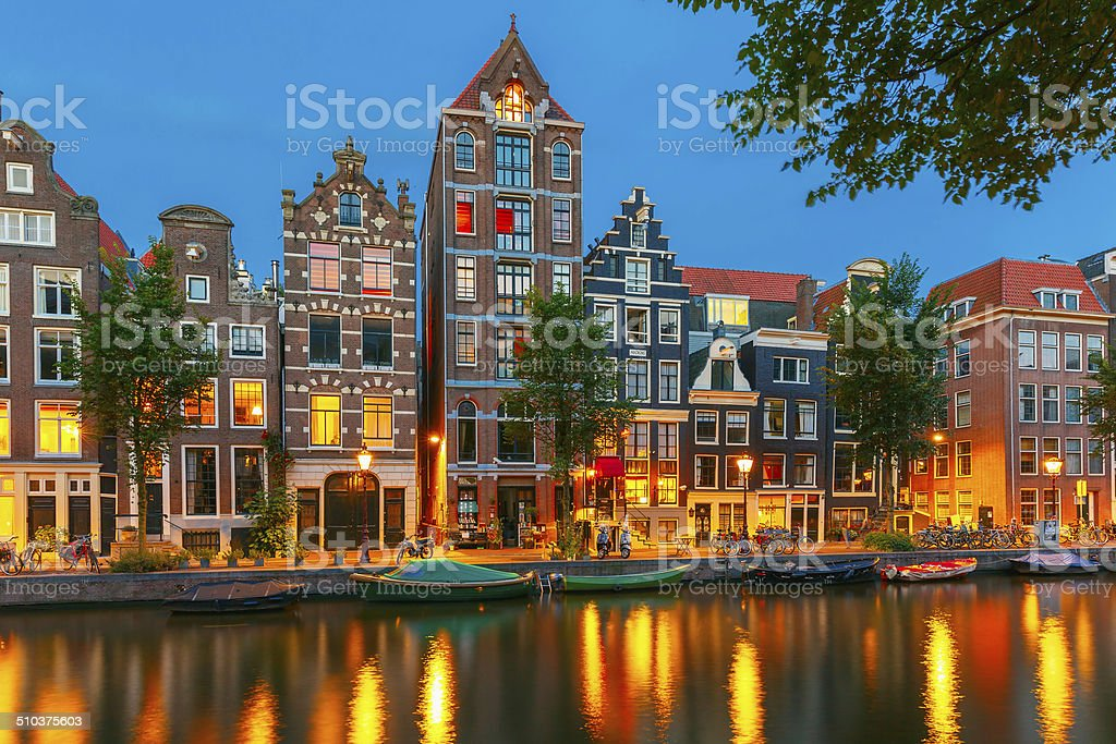 Night city view of Amsterdam canal with dutch houses royalty-free stock photo