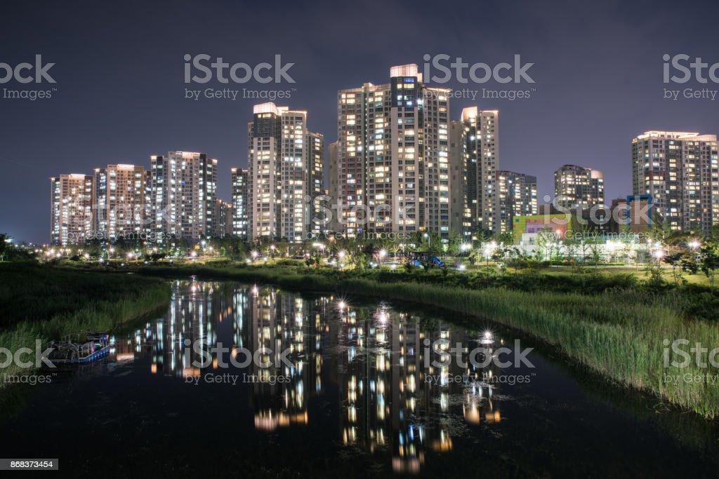 Night cityscape at CHEONGNA (or CHEONGRA) Lakewater park, Incheon, Korea stock photo