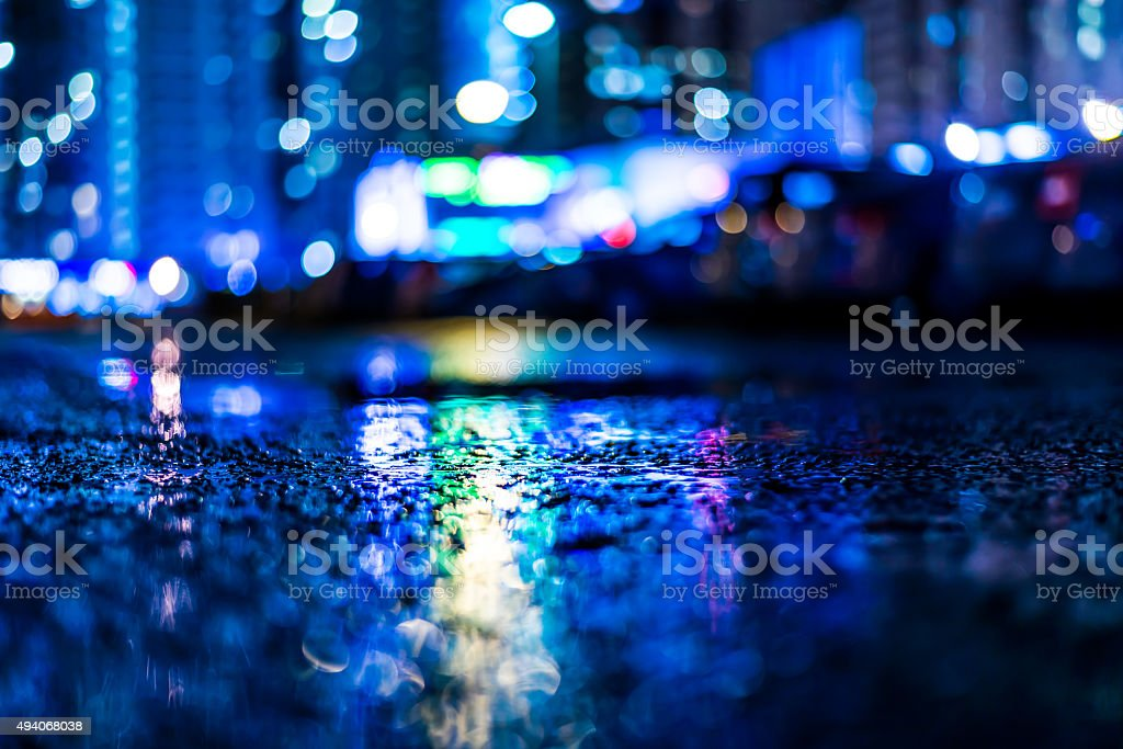 Night cityscape, colored lights reflected in the wet asphalt stock photo