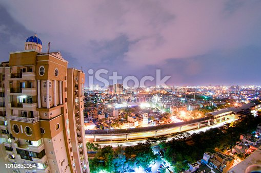 947740086 istock photo night cityscape of noida with skyscraper, monsoon clouds and moo 1010852054