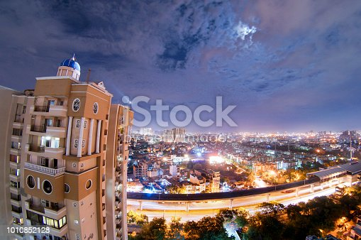 947740086 istock photo night cityscape of noida with skyscraper, monsoon clouds and moo 1010852128