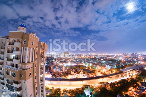 947740086 istock photo night cityscape of noida with skyscraper, monsoon clouds and moo 1010852258