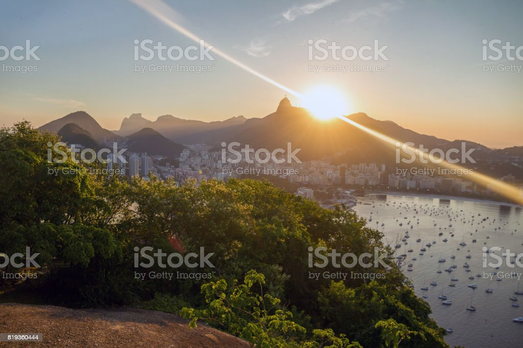 Night cityscape view from the Sugarloaf mountain on the Guanabara bay, Botafogo beach and district, Corcovado mountain with Christ the Redemeer. Rio de Janeiro, Brazil. stock photo
