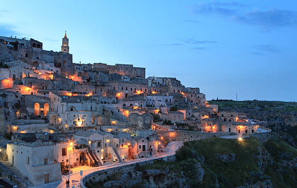Night cityscape view of Matera Sassi, Basilica, Italy Matera Sassi cityscape by night, Basilicata Italy matera italy stock pictures, royalty-free photos & images