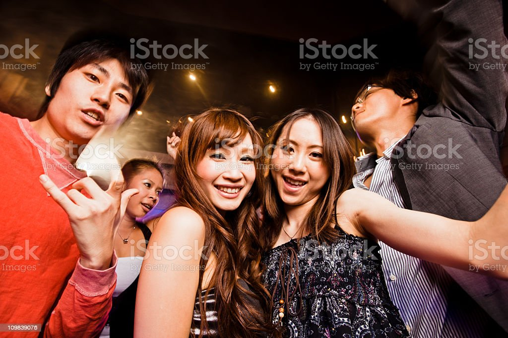 Night Club Disco Party Tokyo Young people having fun, partying and dancing in disco nightclub. Tokyo, Japan. 20-29 Years Stock Photo