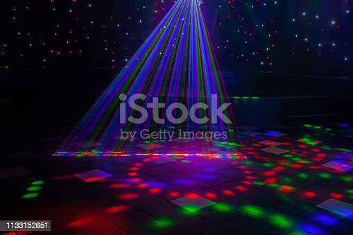 Close up of night club laser lights series from Australian gay bar and nightclub with a stage setting in the background.