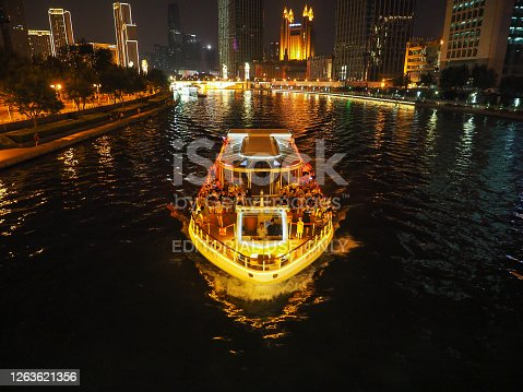 A riverboat going along the Hai river at night in Tianjin, China on August 2019