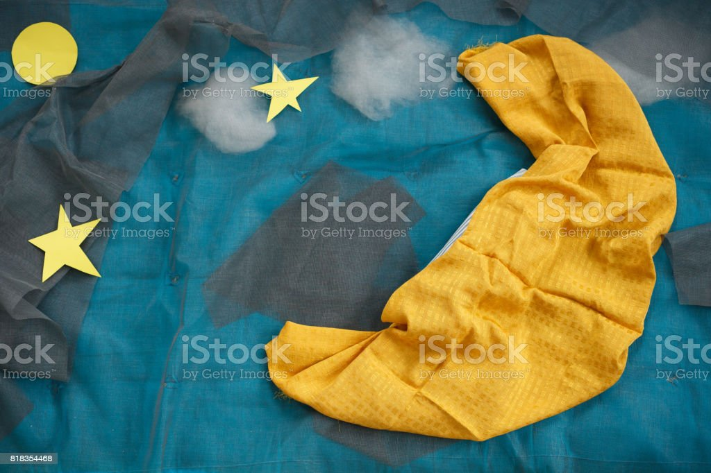 Night decorations of moon and stars for newborn photography. Baby photo decor. Night and sleep concept for children. Textiles for babies. Blues and yellow blankets for babies. Background. stock photo