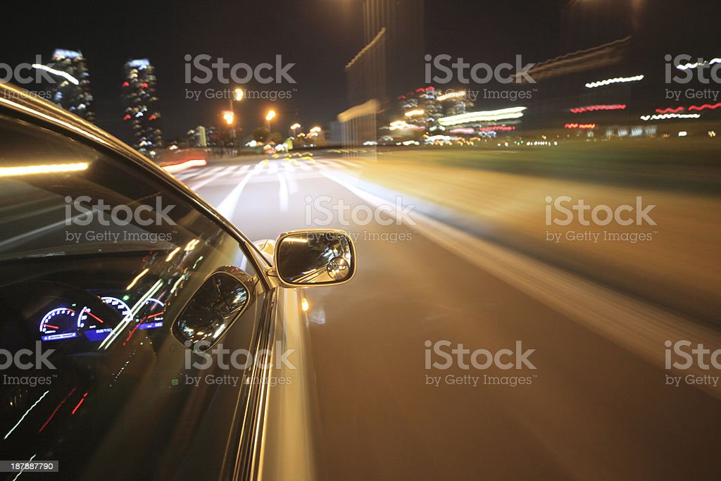 Night drive with car in motion. royalty-free stock photo
