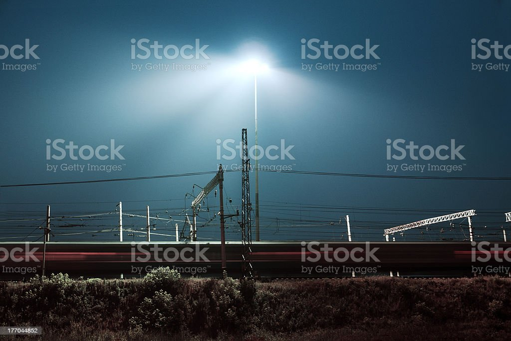 Night express train hurtling at high speed past royalty-free stock photo