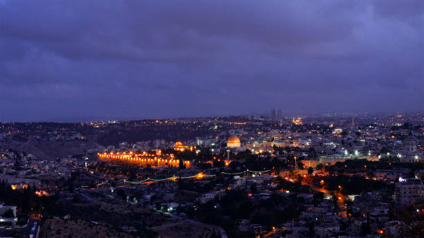 Night falls over Jerusalem city Night falls on Jerusalem city. Citylights light up at night while sunset goes over Jerusalem Dome of the Rock and Al Aqsa mosque. muslim quarter stock pictures, royalty-free photos & images