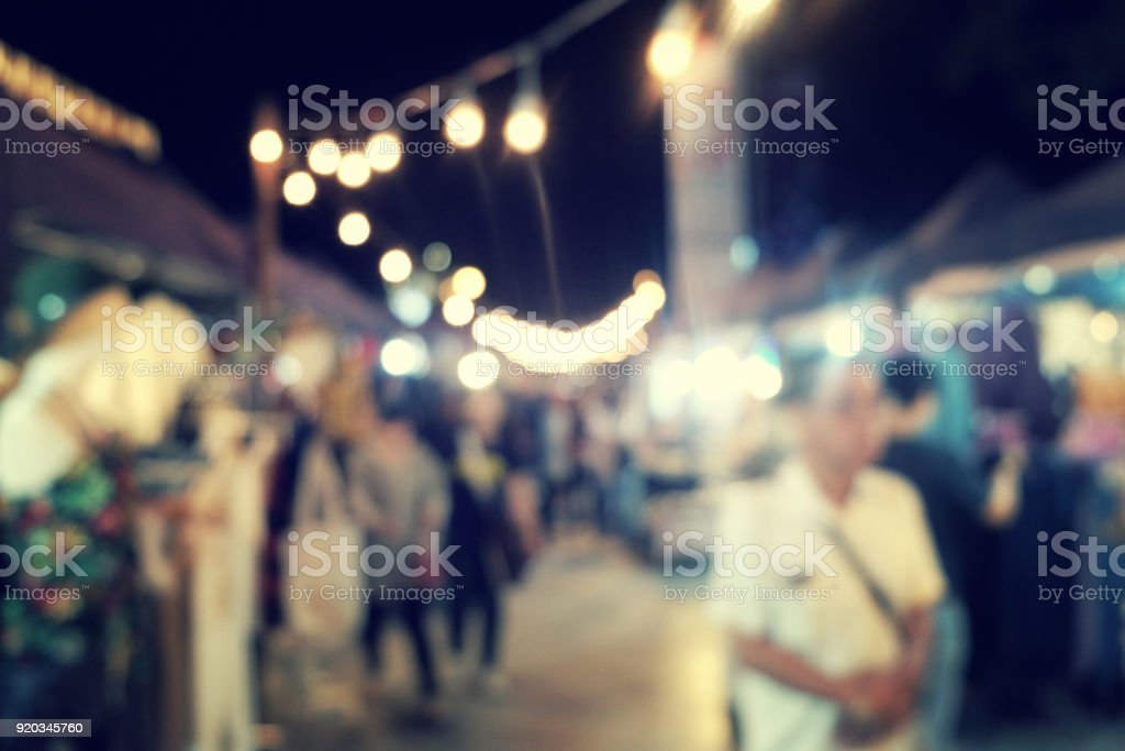 Night Festival Event Party on street with People Blurred Background,...