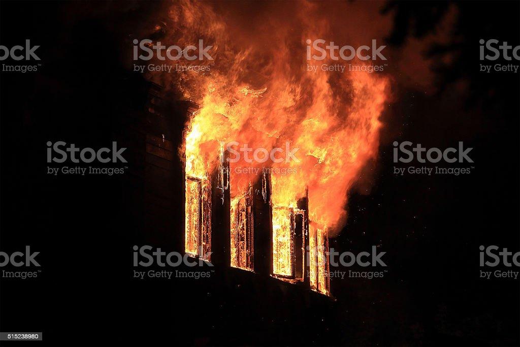 Night fire burning window stock photo