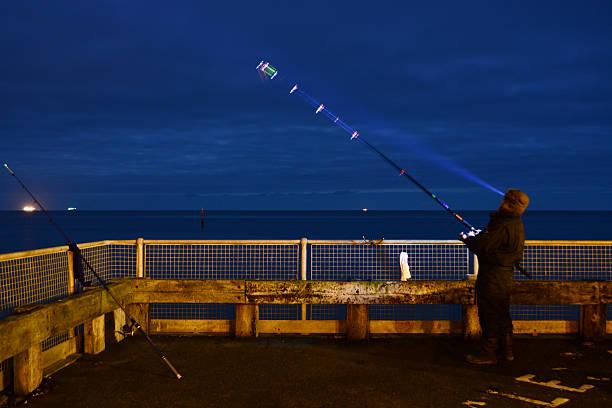 Night Fishing at The Beach stock photo